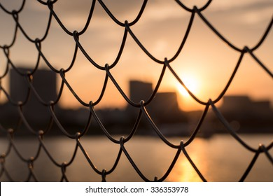 sunset through the fence
