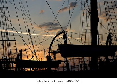 Sunset through the sails of the ship