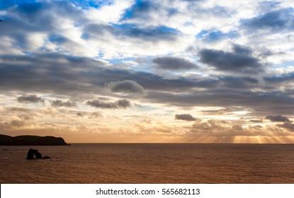 Sunset at Thurlestone rock in Devon, England