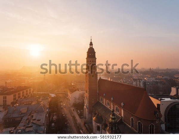 Sunset time, aerial view of church in Krakow, silhouette of church
