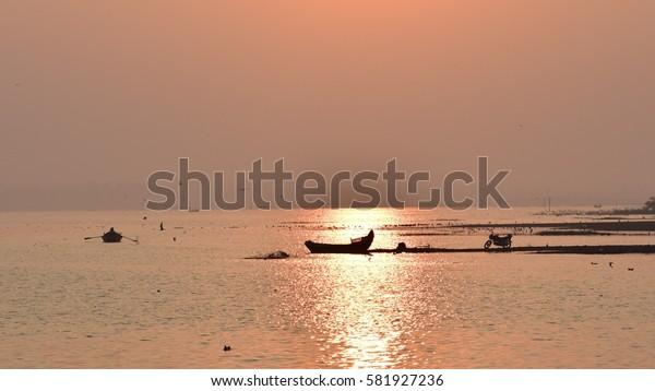 Sunset time fishing boat