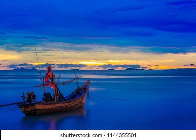 Sunset time and fishing boat. A Kolae boat is a traditional fishing boat used in the southern provinces of Thailand.
