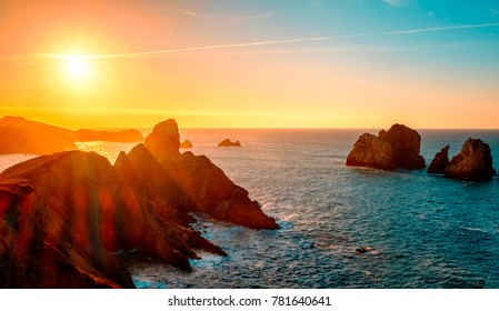 Sunset at the top of a cliff