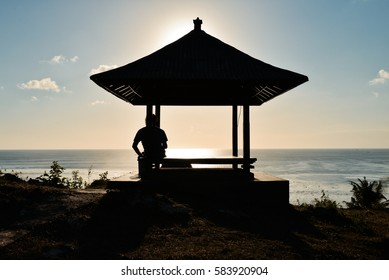 Sunset in the traditional pavilion, Balangan Beach, Bali, Indonesia