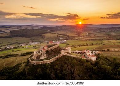 Sunset in Transylvania over citadel Rupea Romania