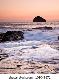Sunset at Trebarwith Strand Cornwall with Gul Rock in the distance.