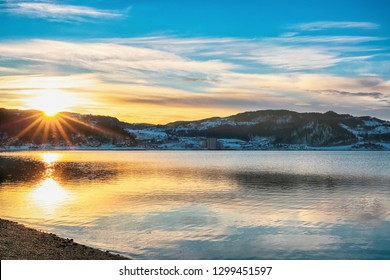 Sunset at Trondheim fjord, the view of the small town Melhus