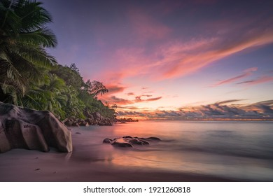 sunset at tropical beach anse georgette on praslin on the seychelles