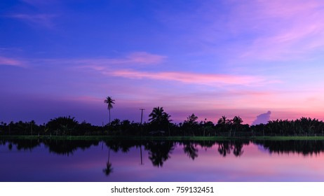 the sunset twilight landscape silhpuette blue sky and river colorfull white balance effec blur background
