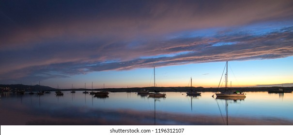 Sunset at twilight over Morro Bay Harbor on the central California coast in California United States