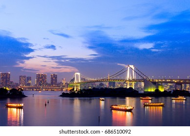 sunset twilight of tokyo skyline, with cityscape and Rainbow Bridge at Odaiba Seaside Park, Odiaba, Tokyo, Japan