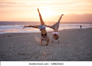 Sunset with Two Beautiful Woman doing cartwheels on the Beach in Santa Monica California