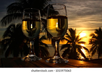 Sunset with two glasses of white wine at Playa Sevilla Beach, Santiago de Cuba, Cuba, shallow focus
