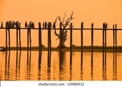 Sunset in U Bein bridge, Myanmar. U Bein bridge is longest teak bridge in the world.