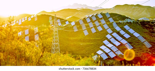 Sunset under the mountain solar photovoltaic panels