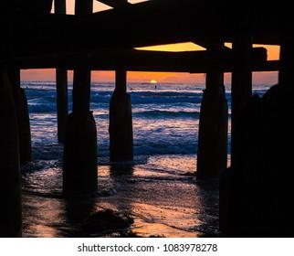 sunset under a san diego pier