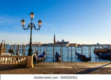 Sunset in Venice. Gondolas at Saint Mark's Square and church of San Giorgio Maggiore on background, Italy, Europe