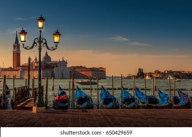 Sunset in Venice with gondolas and street light