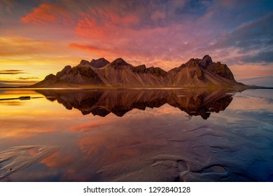 Sunset at Vestrahorn, a 454 metre tall scree mountain, mainly made up of gabbro and granophyre rocks Stokksnes peninsula, East Iceland.