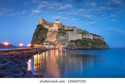 Sunset view of Aragonese Castle or Castello Aragonese - famous landmark and travel destination near Ischia island, Italy.