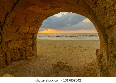 Sunset view of and arch of the Roman Aqueduct in Caesarea, Northern Israel