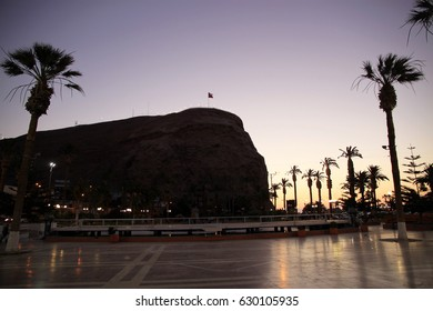 Sunset view in Arica, Chile. Arica is a commune and a port city. It's Chile's northernmost city, located only 18 km south of the border with Peru.The Morro de Arica is a steep hill located in the city