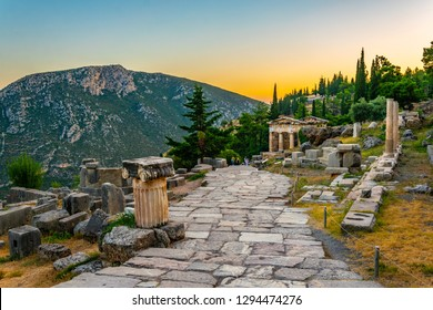 Sunset view of Athenian treasury at the ancient delphi site in Greece