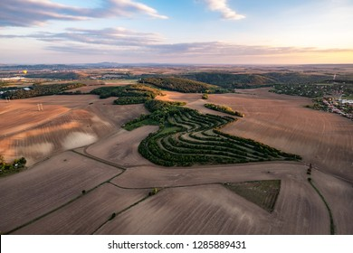 Sunset view of beautiful countryside of South Moravia viewed from above. Agricultural landscape in warm late evening light.