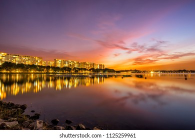Sunset view of Bedok Reservoir, Singapore with colorful skyline and reflection
