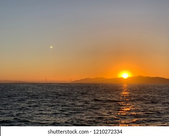 Sunset view from Berkeley CA with Golden Gate Bridge at far view