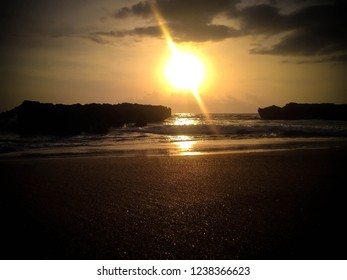 Sunset View Between Rocks And The Sea Weaves Of Batu Bolong Beach, Canggu Village, Badung, Bali, Indonesia