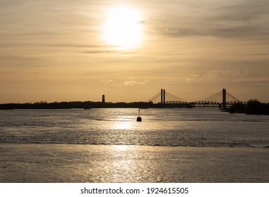 sunset view of bridge over river Waal near Zaltbommel
