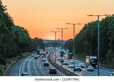 Sunset view of busy UK Motorway traffic in England
