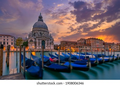 Sunset view of Canal Grande with Venice gondola and Basilica di Santa Maria della Salute in Venice, Italy. Architecture and landmarks of Venice. Venice postcard