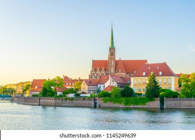 Sunset view of church of the Holy Cross and St Bartholomew in Wroclaw, Poland