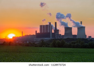 Sunset view at Coal-fired power plant near lignite mine Inden in Germany