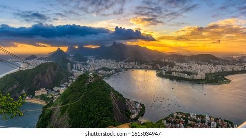Sunset view of Copacabana, Corcovado, Flamengo, Botafogo and Centro in Rio de Janeiro, Brazil. Panorama of Rio de Janeiro and Guanabara bay. Skyline of Rio de Janeiro