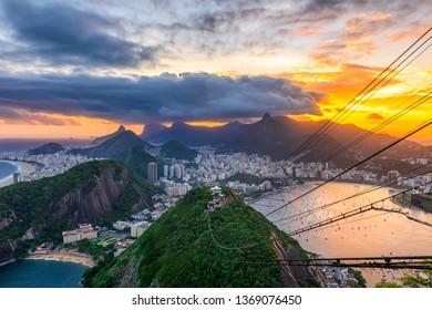 Sunset view of Copacabana,  Corcovado, Urca and Botafogo in Rio de Janeiro, Brazil. Skyline of Rio de Janeiro. Postcard of Rio de Janeiro