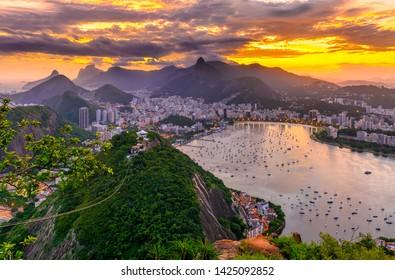 Sunset view of Corcovado, Botafogo and Guanabara bay in Rio de Janeiro, Brazil. Skyline of Rio de Janeiro. Sunset cityscape of Rio de Janeiro