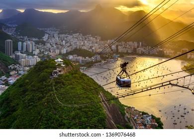 Sunset view of Corcovado, Urca and Botafogo in Rio de Janeiro, Brazil. Skyline of Rio de Janeiro. Postcard of Rio de Janeiro