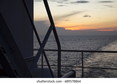Sunset View  From The Deck Of A Tanker Ship Deck Silhouette  In Ocean