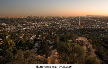 Sunset view of the downtown Los Angeles skyline at night, from Griffith Observatory, in Griffith Park, Los Angeles, California.
