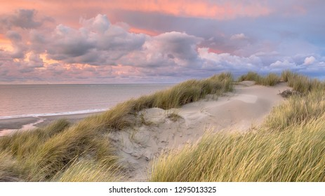 Sunset View from dune on North Sea and Canal in Zeeland, Netherlands