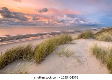 Sunset View from dune over North Sea and Canal in Zeeland, Netherlands