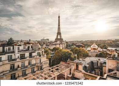 Sunset view to Eiffel tower in Paris, France from the rooftop.