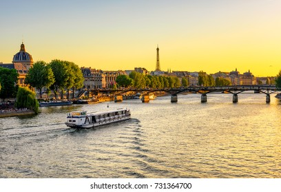 Sunset view of Eiffel tower, Pont des Arts and Seine river in Paris, France. Architecture and landmarks of Paris. Postcard of Paris