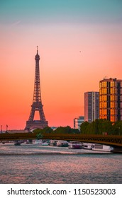 Sunset view of  Eiffel Tower and river Seine in Paris, France.