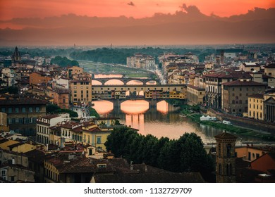 Sunset view of the famous Ponte Vecchio bridge in downtown Florence, Italy