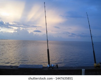Sunset view fishing saltwater ocean gulf lake clouds sky
