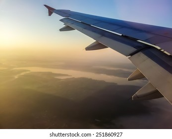 Sunset view in flight from airplane window